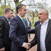 Monacan Chief, Dean Branham, right greets Virginia Governor, Ralph Northam, following the dedication ceremony for Mantle: Virginia Indian Tribute, a monument designed on Virginia State Capitol Square, in Richmond, Virginia, on Tuesday, April 17, 2018. John Boal Photography