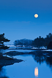 Moonrise over Chauncey Creek in winter. Kittery, Maine. Tidal creek. Maine Coast.