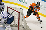 RIT forward Mark Logan skates the puck behind the Air Force net during the Atlantic Hockey semifinal at the Blue Cross Arena at the War Memorial in Rochester on Friday, March 18, 2016.
