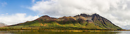 Composite panorama of the Clearwater Mountains and the Old Susitna Lodge near Windy Creek along the Denali Highway in Southcentral Alaska. Autumn. Afternoon.