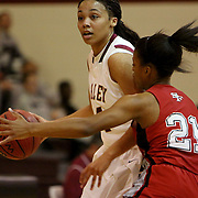Ashley's Felecity Havens drives past 71st's Ambryia Davis. (Jason A. Frizzelle)