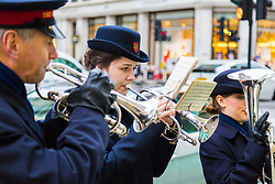 London, December 23 2017. Salvation Army band plays on Regent Street as Shoppers crowd London's west end on the second last shopping days before Christmas, with many shops now offering up to 70% off as they push to make their sales projections. © Paul Davey