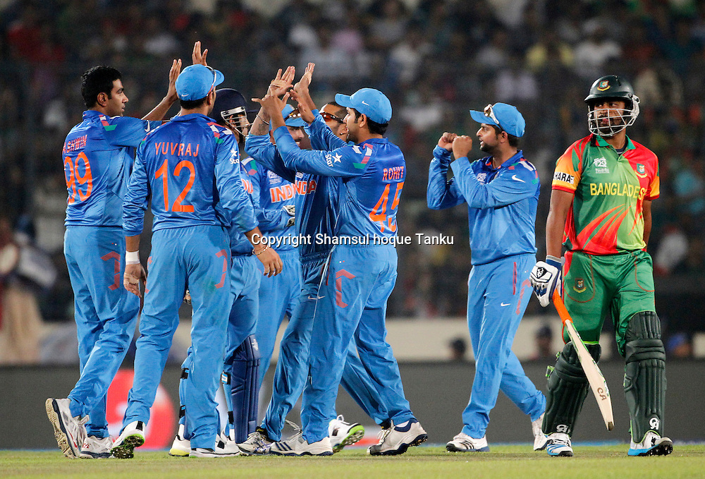 India team celebrates wicket of Tamim Iqbal - nBangladesh v India - ICC World Twenty20, Bangladesh 2014. 29 March 2014, Sher-e-Bangla National Cricket Stadium, Mirpur. Photo: Shamsul hoque Tanku/www.photosport.co.nz