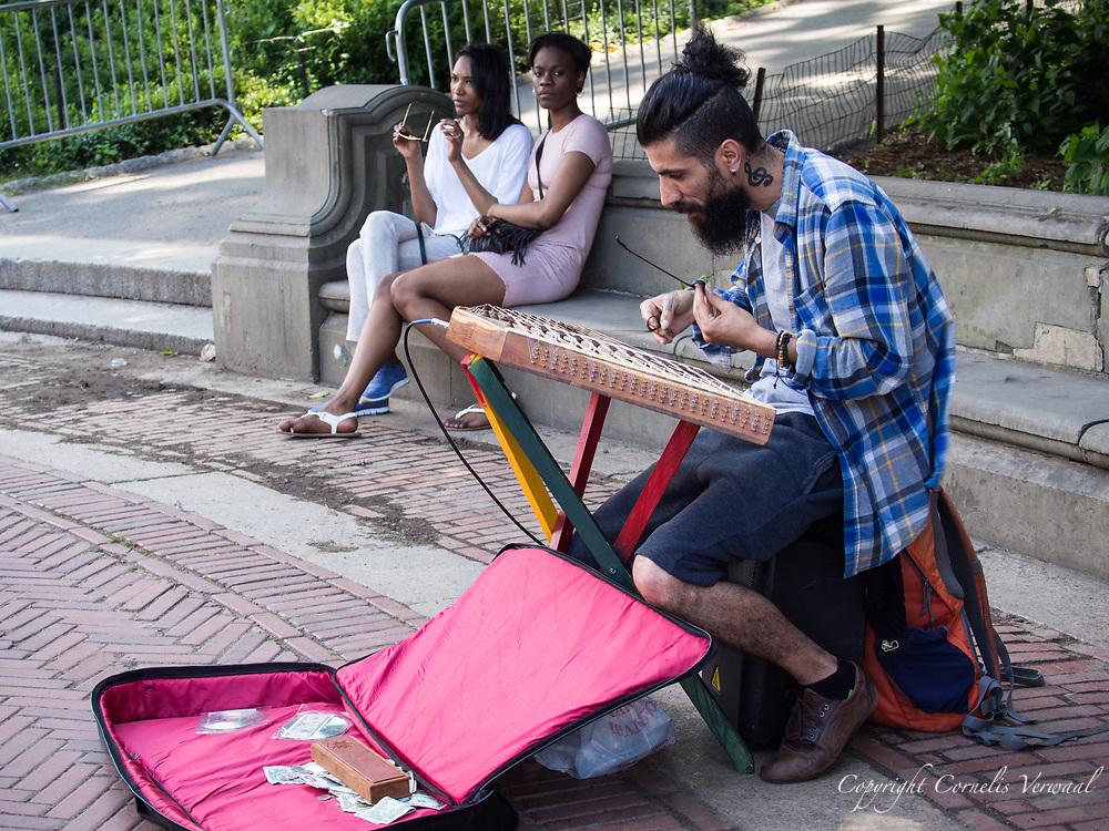 Hammer dulcimer player at Bethesda Terrace in Central Park
