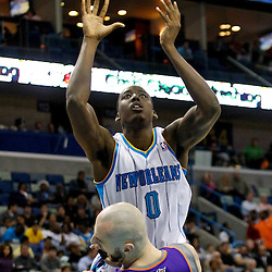 December 30, 2011; New Orleans, LA, USA; New Orleans Hornets small forward Al-Farouq Aminu (0) charges into Phoenix Suns center Marcin Gortat (4) during the second quarter of a game at the New Orleans Arena.   Mandatory Credit: Derick E. Hingle-US PRESSWIRE