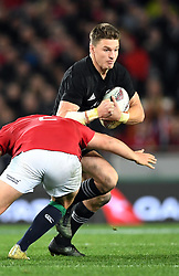 Beauden Barrett of New Zealand steps around Jamie George of the Lions in the third International rugby test match between the the New Zealand All Blacks and British and Irish Lions at Eden Park, Auckland, New Zealand, Saturday, July 08, 2017. Credit:SNPA / Ross Setford  **NO ARCHIVING""