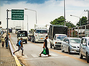 25 OCTOBER 2016 - MAE SOT, TAK, THAILAND:  People on the Friendship Bridge enter Thailand through the Thai customs and immigration post in Mae Sot on the Thai side of the border with Myanmar. The Thai-Myanmar border between Mae Sot and Myawaddy has become an important commercial crossing as democratic reforms in Myanmar (Burma) has created new economic opportunities in Thailand.   PHOTO BY JACK KURTZ