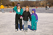 three girls by ice rink on a lake in Minneapolis Minnesota