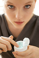 Close-up of woman holding facial cleanser