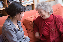 IndependentAge volunteer and older woman laughing together,
