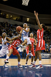 North Carolina guard Cetera DeGraffenreid (22) beats Georgia guard Christy Marshall (22) and forward Angel Robinson (33) to the basket.  The #1 seed North Carolina Tar Heels defeated the Georgia Bulldogs 80-66 in the second round of the 2008 NCAA Women's Basketball Championship at the Ted Constant Convocation Center in Norfolk, VA on March 25, 2008.