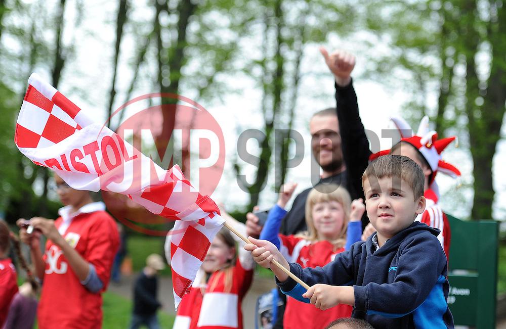 Bristol City fan looks on as the Celebration tour bus passes - Photo mandatory by-line: Dougie Allward/JMP - Mobile: 07966 386802 - 04/05/2015 - SPORT - Football - Bristol -  - Bristol City Celebration Tour