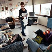 Rosa Emilia Giancola, 44 anni, operaia e delegata RSU FEMCA CISL per la Tacconi Sud di Latina, e' ritratta mentre parla con le colleghe Anna Porcelli 54 anni e Maria Nicoletta Di Giandomenico 55 anni nell'appartamento, situato all'interno dello stabilimento, prima riservato al direttore di produzione, dove ora vivono le operaie giorno e notte. Anna e Maria Nicoletta lavorano a maglia, uno dei principali passatempi ai quali si dedicano alcune operaie quando fanno il turno per presidiare la fabbrica. L'occupazione e' iniziata il 19 gennaio 2011 a seguito della comunicazione del licenziamento di tutte le dipendenti. La produzione dell'impianto e' ferma e l'intento delle donne e' quello di salvaguardare i materiali ancora al suo interno e di chiedere garanzie per il loro futuro lavorativo. Rosa, Anna e Nicoletta hanno lavorato alla Tacconi Sud per 20 anni.