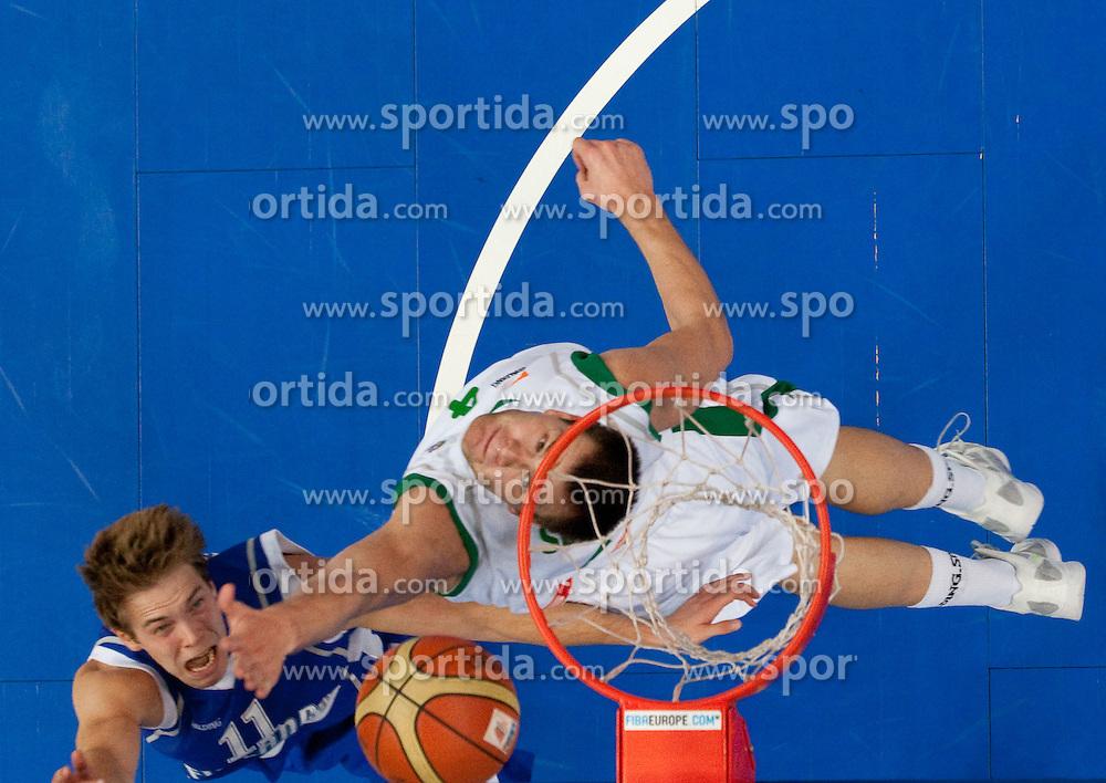 Petteri Koponen of Finland vs Uros Slokar of Slovenia during basketball game between National basketball teams of Slovenia and Finland at FIBA Europe Eurobasket Lithuania 2011, on September 12, 2011, in Siemens Arena,  Vilnius, Lithuania.  Slovenia defeated Finland 67-60. (Photo by Vid Ponikvar / Sportida)