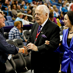 November 9, 2012; New Orleans, LA, USA; New Orleans Hornets and Saints owners Tom Benson and Gayle Benson talk with fan Quint Davis at halftime of a game against the Charlotte Bobcats at the New Orleans Arena. Mandatory Credit: Derick E. Hingle-US PRESSWIRE