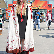 London,England,UK : 27th May 2016 : Hundreds of young people dress in cosplay, sci-fi, fantasy and superhero costumes hanging around the open space of Excel London poshing for photoshoot on the first day of MCM London Comic Con, London. Photo by See Li