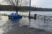 © Licensed to London News Pictures. 03/01/2014. Godalming, UK. A car sits in floodwater.  Flooding in Godalming. River Wey bursting it's banks in Surrey today 3rd January 2013. Floods an heavy rain are continuing to effect travel and people across the country today. Photo credit : Stephen Simpson/LNP