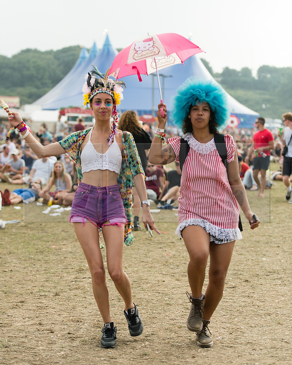 © Licensed to London News Pictures. 07/09/2014. Isle of Wight, UK. Festival goers  at Bestival 2014 wearing fancy dress dance and listen to live music on  Day 4 Sunday the final day of the festival. This weekend's headliners include Chic featuring Nile Rodgers, Foals and Outcast.   Bestival is a four-day music festival held at the Robin Hill country park on the Isle of Wight, England. It has been held annually in late summer since 2004.    Photo credit : Richard Isaac/LNP