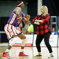 Thomas Wells | Buy at PHOTOS.DJOURNAL.COM<br /> Megan McCormick of Calhoun City gets pulled into a dance contest during Tuesday Harlem Globetrotters performance on Tuesday.