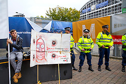 © Licensed to London News Pictures. 06/10/2015. Manchester, UK. Anti-austerity protesters demonstrating outside Conservative Party Conference at Manchester Central convention centre on Tuesday, 6 October 2015. Photo credit: Tolga Akmen/LNP