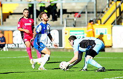 Dover Athletic's Andy Rafferty collects from the feet of Bristol Rovers' Matty Taylor - Photo mandatory by-line: Neil Brookman - Mobile: 07966 386802 - 04/10/2014 - SPORT - Football - Bristol - Memorial Stadium - Bristol Rovers v Dover - Vanarama Football Conference