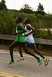 lead runners at mile 3, Lucas Rotich and Micah Kogo of Kenya, the eventual winner and runner-up