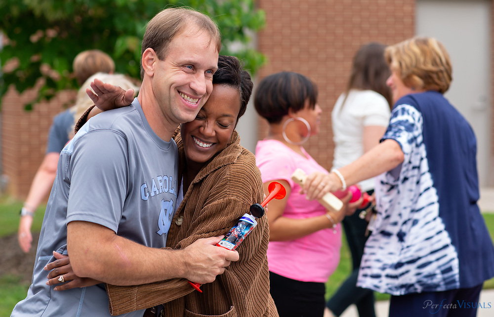 Last day of school at Ronald E. McNair Elementary School.<br /> <br /> Teachers David Cranor and Kimberley Cathey hug after a loud sendoff for their students.<br /> <br /> Photographed, Tuesday, June 12, 2018, in Greensboro, N.C. JERRY WOLFORD and SCOTT MUTHERSBAUGH / Perfecta Visuals
