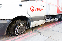 © Licensed to London News Pictures. 05/05/2018. London, UK. A damaged van covered in police tape on London Bridge. Earlier this morning the Metropolitan Police reported that London Bridge had closed due to theft of a van which resulted in the driver falling in the River Thames.  Photo credit: Vickie Flores/LNP