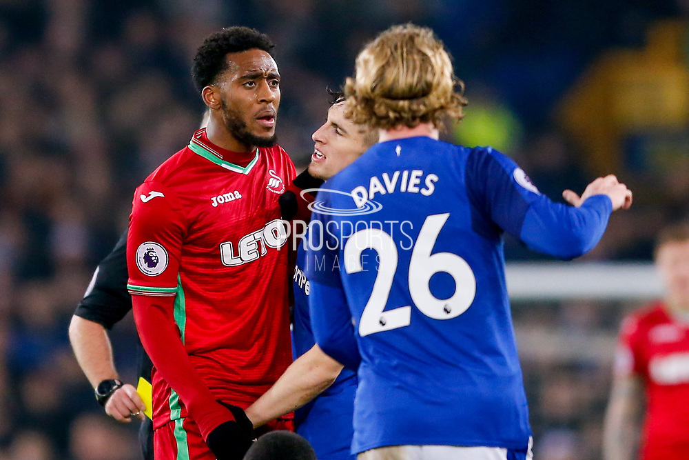 Swansea City midfielder Leroy Fer (8) and Everton defender Jonjoe Kenny (43) have words during the Premier League match between Everton and Swansea City at Goodison Park, Liverpool, England on 18 December 2017. Photo by Simon Davies.