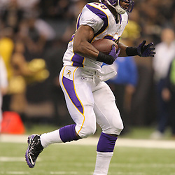 Jan 24, 2010; New Orleans, LA, USA; Minnesota Vikings running back Adrian Peterson (28) runs with the ball during a 31-28 overtime victory by the New Orleans Saints over the Minnesota Vikings in the 2010 NFC Championship game at the Louisiana Superdome. Mandatory Credit: Derick E. Hingle-US PRESSWIRE