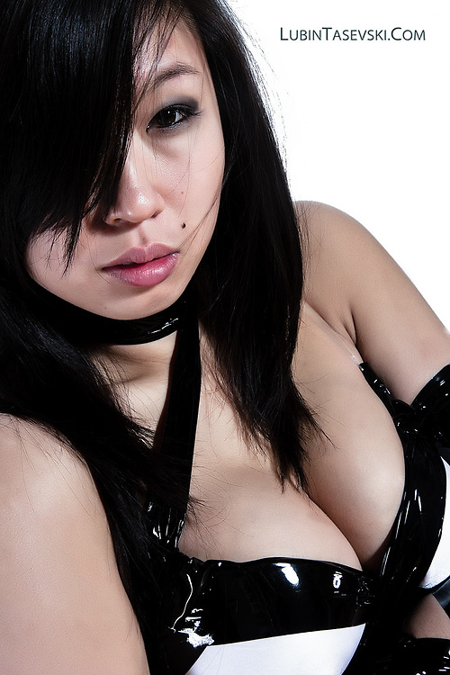 J T W - Sexy Asian wrapped in bondage tape