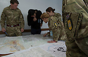 Officers from the Military Stabilisation &amp; Support Group study maps of Bosnia &amp; Herzegovina with the help of an interpreter during Exercise Civil Bridge. 09/03/2015. <br /> <br /> Exercise Civil Bridge is an Overseas Training Exercise (OTX) conducted twice a year in support of UK Defence Engagement by elements of 77 Brigade. Civil Bridge 14B(CB 14B) is being conducted in Sarajevo, Bosnia and Herzegovina (BiH).  By assisting the BiH Government to develop their contingency plans for natural disasters at both strategic and operational levels, CB14B will contribute to the long term international effort to stabilise BiH ethinic groups and authorities.<br /> <br /> Credit should read: Cpl Mark Larner RY/MOD<br /> <br /> (c)MOD 2015
