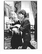 Jerry Hall and Mick Jagger January 1992© Copyright Photograph by Dafydd Jones 66 Stockwell Park Rd. London SW9 0DA Tel 020 7733 0108 www.dafjones.com