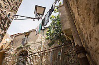 GANGI, ITALY - 30 MAY 2015: A house sold for free is here in the historical center of Gangi, Italy, on May 30th 2015. Gangi is a town with a population of 7,000 between Palermo and Catania, in the centre of Sicily, whose local administration is giving away abandoned houses of the historical centre for free. The Mayor of Gangi Giuseppe Ferrarello conceived the initiative of giving houses for free as a means to diversify the local economy - primarily dependent on agriculture and animal husbandry - by boosting tourism-related activities, and consequently counteract the phenomenon of depopulation that is typical of many small Italian towns where employment possibilities have been on a downward trajectory for years. The renovations of the assigned homes have also given work to local artisans.