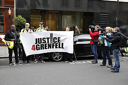 © Licensed to London News Pictures. 14/09/2017. London, UK. Protestors stand outside The Connaught Rooms on the first day of the public inquiry into the Grenfell fire. Police say they believe 80 people died in the tragedy. Photo credit: Peter Macdiarmid/LNP
