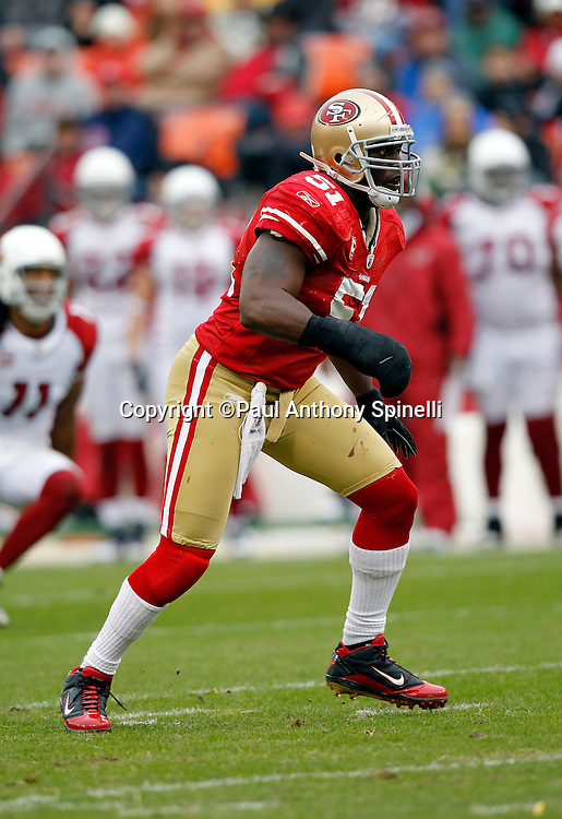 San Francisco 49ers linebacker Takeo Spikes (51) chases the action while wearing a large wrap around his right hand and wrist during the NFL week 17 football game against the Arizona Cardinals on Sunday, January 2, 2011 in San Francisco, California. The 49ers won the game 38-7. (©Paul Anthony Spinelli)