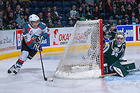 KELOWNA, CANADA - JANUARY 22: Nick Merkley #10 of the Kelowna Rockets skates with the puck behind the net of Austin Lotz #30 of the Everett Silvertips during the second period on January 22, 2014 at Prospera Place in Kelowna, British Columbia, Canada.   (Photo by Marissa Baecker/Getty Images)  *** Local Caption *** Nick Merkley; Austin Lotz;