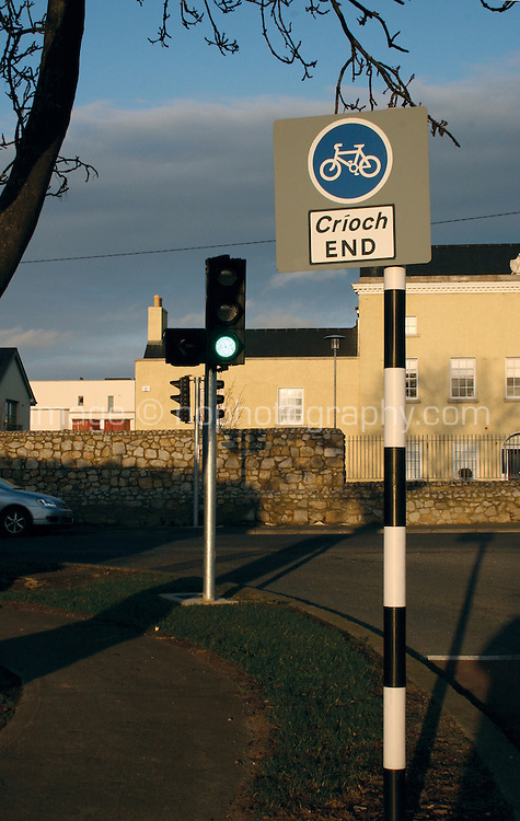 Cycle lane ends signpost beside traffic lights in Dublin Ireland