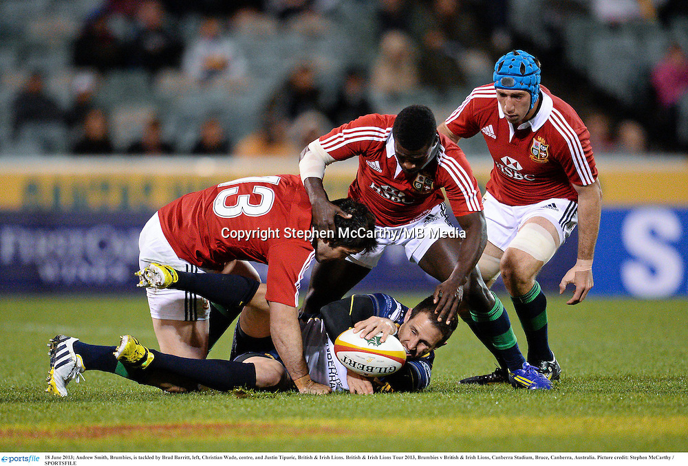 18 June 2013; Andrew Smith, Brumbies, is tackled by Brad Barritt, left, Christian Wade, centre, and Justin Tipuric, British & Irish Lions. British & Irish Lions Tour 2013, Brumbies v British & Irish Lions, Canberra Stadium, Bruce, Canberra, Australia. Picture credit: Stephen McCarthy / SPORTSFILE