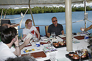Tilda swinton and Tim Lott, Judges meeting on the floating restaurant. Preparing for the Le Prince Maurice Prize. Mauritius. 27 May 2006. ONE TIME USE ONLY - DO NOT ARCHIVE  © Copyright Photograph by Dafydd Jones 66 Stockwell Park Rd. London SW9 0DA Tel 020 7733 0108 www.dafjones.com