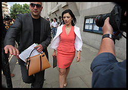 Asil Nadir's wife Nur leaving the Old Bailey in London after he was sentenced to 10 years in prison, Thursday, 23rd August . Photo by: Stephen Lock / i-Images