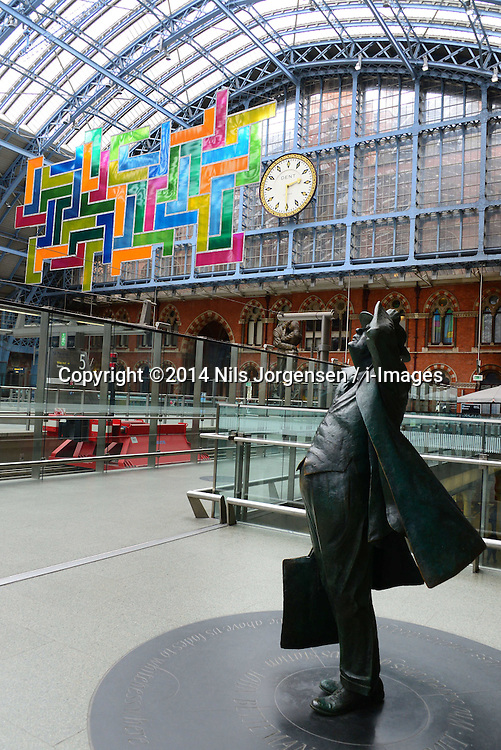 Chromolocomotion, work by Scottish artist David Batchelor, at London's St Pancras International Station, part of the Terrace Wires art programme, features 44 brightly coloured perspex 'L' shapes, at St Pancras International Station, London, United Kingdom. Saturday, 12th April 2014. Picture by Nils Jorgensen / i-Images