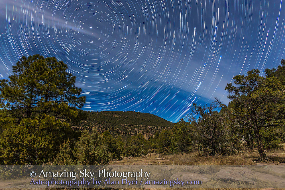 Circumpolar star trails on a moonlit night in the Gila National Forest in southern New Mexico, north of Pinos Altos. Polaris is at upper left, the Little Dipper hanging below it, and the stars of the Big Dipper are rising at right, with the end star of the handle still to clear the horizon. Illumination is from the waxing quarter Moon. The night had a lot of high cloud drifting through, adding the streaks and patchiness to the sky. <br /><br />This is a stack of 80 exposures, each 45 seconds with the 24mm lens at f/4 and Canon 6D at ISO 1600. The foreground comes from a single frame, the first, to minimize blurring and contrast loss from using a foreground blended from 80 shots taken over an hour while the Moon and shadows moved. The last frame was enhanced with larger star glows to punch up the appearance of the end stars and pattern of the Dipper. Stacking was performed with the Star Circle Academy&rsquo;s Advanced Stacker Actions, using the Long Streaks effect.