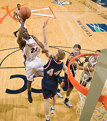 Virginia guard/forward Mamadi Diane (24) shoots a jumper over Richmond guard/forward Ryan Butler (44).  The Virginia Cavaliers men's basketball team defeated the Richmond Spiders 66-64 in the first round of the College Basketball Invitational (CBI) tournament held at the University of Virginia's John Paul Jones Arena in Charlottesville, VA on March 18, 2008.