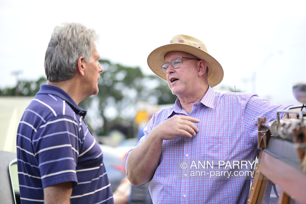 Bellmore, New York, USA. 11th August 2017.  At right, MIKE RADOMSKI, of Valley Stream, owner of 1967 Wunderbug Volkswagen, and BRYAN RICHHEIMER, of Vermont, chat at Bellmore Friday Night Car Show.