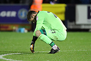 Lincoln City goalkeeper Josh Vickers (21) looking at floor during the The FA Cup match between AFC Wimbledon and Lincoln City at the Cherry Red Records Stadium, Kingston, England on 4 November 2017. Photo by Matthew Redman.