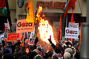 10/01/2009 A banner is set alight during clashes outside the Israeli Embassy in protest against the war in Gaza