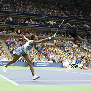 Venus Williams, USA, in action against her sister Serena Williams, USA, in the  Women's Singles Quarterfinals match during the US Open Tennis Tournament, Flushing, New York, USA. 8th September 2015. Photo Tim Clayton