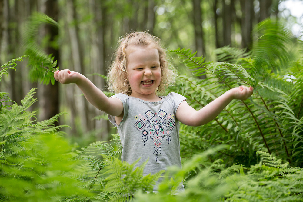 "Young girl playing in woodland as part of ""Mucky Boots"" forest Kindergarten group, Aberdeen, Scotland.<br /> (MR available)"