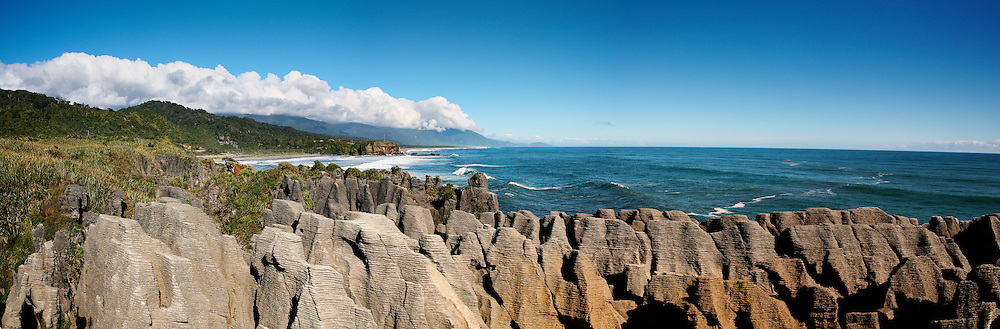 wide angle view of pancake rocks and blow holes on the nz coast at punakaiki, west coast, new zealand